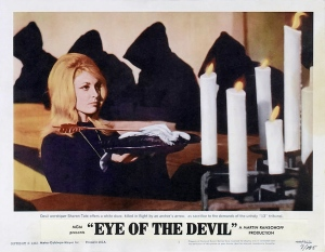 American colorized lobbycard featuring Odile (Sharon Tate) offering the dove Christian killed at the ritual.